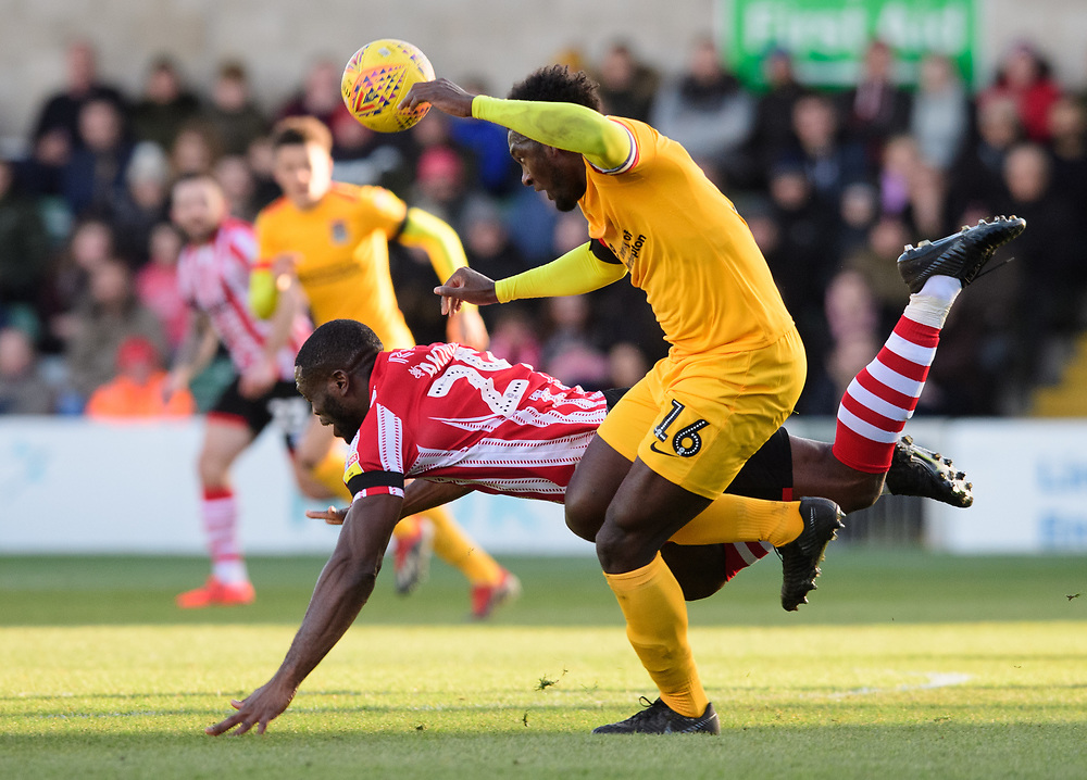 Lincoln City's John Akinde is fouled by Northampton Town's Aaron Pierre<br /> <br /> Photographer Chris Vaughan/CameraSport<br /> <br /> The EFL Sky Bet League Two - Lincoln City v Northampton Town - Saturday 9th February 2019 - Sincil Bank - Lincoln<br /> <br /> World Copyright © 2019 CameraSport. All rights reserved. 43 Linden Ave. Countesthorpe. Leicester. England. LE8 5PG - Tel: +44 (0) 116 277 4147 - admin@camerasport.com - www.camerasport.com