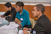 Purchase, NY – 31 October 2014. Kevin Disln, right, and team members from Gorton High School listening to their team members. The Business Skills Olympics was founded by the African American Men of Westchester, is sponsored and facilitated by Morgan Stanley, and is open to high school teams in Westchester County.