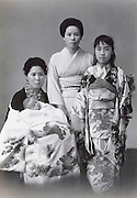 formal portrait of Japanese women with new born baby 1965