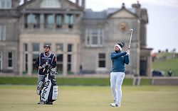 England's Tyrell Hatton plays his approach into the 1st green during day three of the Alfred Dunhill Links Championship at The Old Course, St Andrews.