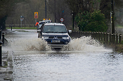 © Licensed to London News Pictures 28/12/2020.        Yalding, UK. Traffic driving in flood water. Yalding village in Kent and surrounding areas are flooded due to the River Medway and River Beult bursting their banks. Photo credit:Grant Falvey/LNP