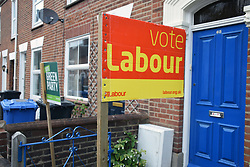 Norwich 2 days before the local elections. 2 May 2017. UK. This house has both Labour Party & Green Party signs