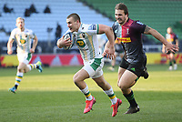 Rugby Union - 2020 / 2021 Gallagher Premiership - Round 12 - Harlequins vs Northampton Saints - The Stoop<br /> <br /> Northampton Saints' Ollie Sleightholme evades the tackle of Harlequins' Andre Esterhuizen to score his sides third try.<br /> <br /> COLORSPORT/ASHLEY WESTERN