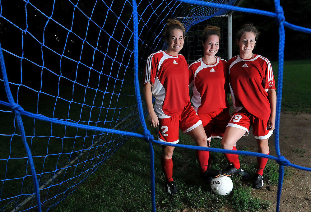 Soccer playing sisters Jess, 24, left, Nikki, 22, center, and Melanie Steir, 15, right, pose for a portrait prior to their soccer game in Monson, Mass.