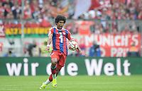 Fotball<br /> Tyskland<br /> 13.09.2014<br /> Foto: Witters/Digitalsport<br /> NORWAY ONLY<br /> <br /> Dante (Bayern) mit Bande 'wir die Welt'<br /> <br /> Fussball Bundesliga, FC Bayern München - VfB Stuttgart 2:0