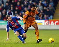 Photo: Chris Ratcliffe.<br />Crystal Palace v Wolverhampton Wanderers. Coca Cola Championship. 10/12/2005.<br />Tom Huddlestone (R) of Wolves tussles with Michael Hughes.