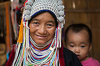 The Akha are a hill tribe of subsistence farmers known for their artistry.  Most of the remaining Akha live in small villages in the mountains of China, Laos, Myanmar and Thailand.  The Akha subsist through an often destructive form of slash and burn agriculture which can result in elimination of old growth forest, native animal species and serious soil runoff problems. They are expert farmers who focus on mountain rice, corn, and soybeans that are planted in seasonal shifts. The Akha are also very efficient hunters, though their prey sometimes includes endangered species.