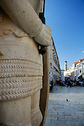 Detail of hand and sword handle, Orlando's column, with Stradun (Placa) in background. Dubrovnik old town, Croatia