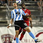 Wilmington foward Chris Banks (18) heads the ball during a United Soccer League Pro soccer match between the Wilmington Hammerheads and the Orlando City Lions at the Florida Citrus Bowl on June 18, 2011 in Orlando, Florida.  (AP Photo/Alex Menendez)