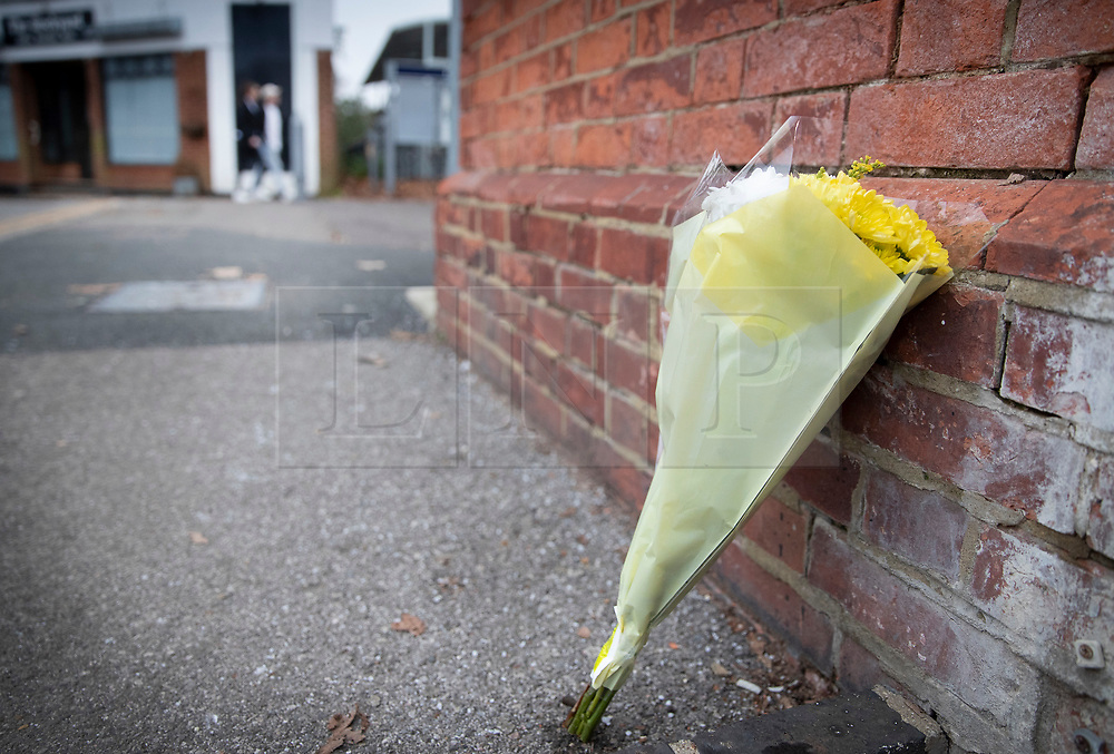 © Licensed to London News Pictures. 05/01/2019. Horsley, UK. A floral tribute is left outside Horsley station in Surrey where a man was stabbed to death on a train yesterday. A murder investigation has been launched after the man was attacked while on board the 12. 58pm train service travelling between Guildford and London Waterloo. A man and a woman have been detained by police in Farnham in connection with the murder. Photo credit: Peter Macdiarmid/LNP