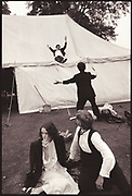 Sliding down the marquee during the New College May Ball. Oxford. 24 June 1983.