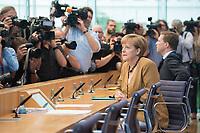 18 JUL 2014, BERLIN/GERMANY:<br /> Angela Merkel, CDU, Bundeskanzlerin, vor Beginn der sog. Sommer-Pressekonferenz der Bundeskanzlerin zu aktuellen Themen der Innen- und Außenpolitik, Bundespressekonferenz<br /> IMAGE: 20140718-01-009<br /> KEYWORDS: Kamera, Camera, Journalist, Journalisten, Fotografen, Kameraleute