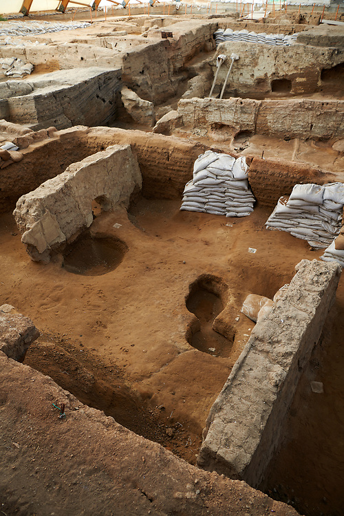 Empty burial pits inside a Neolithic remains of mud brick houses of the north ecavation area, Catalyhoyuk Archaeological Site, Çumra, Konya, Turkey