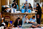 The congregation of Austin Gurdwara shares a communal meal called Langar in the trailer that once housed their sanctuary.  The congregation began worshiping in 2003 in the mobile home on property they purchased in far west Austin.  In 2005, the congregation obtained the necessary permits to begin construction of a new temple and faced no opposition until John and Leslie Bollier moved into the neighborhood in 2008 and filed suit claiming the temple violated the subdivision's restrictions on commercial building.<br /> <br /> A trial judge sided with Austin Gurdwara in March 2009 and construction of the temple was completed in April 2010. In July, a Texas appellate court overturned the 2009 decision and ruled that the new temple must be razed or moved.  The Sikh community is appealing that decision to the Texas Supreme Court.