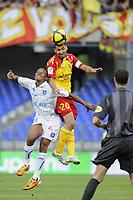 FOOTBALL - FRENCH CHAMPIONSHIP 2010/2011 - L1 - AJ AUXERRE v RC LENS - 24/04/2011 - PHOTO ALAIN GADOFFRE / DPPI - ADIL HERMACH (RCL)/ KOSSI SEGBEFIA (AJA)