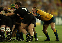Photo: Richard Lane.<br />New Zealand v Australia. Semi-Final, at the Telstra Stadium, Sydney. RWC 2003. 15/11/2003. <br />Phil Waugh prepares to pounce.