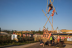 Trucks queue as anti-HS2 activists use a tripod to block one of several entrances blocked to the Chiltern Tunnel South Portal site for the HS2 high-speed rail link on 9 October 2020 in West Hyde, United Kingdom. The protest action, at the site from which HS2 Ltd intends to drill a 10-mile tunnel through the Chilterns, was intended to remind Prime Minister Boris Johnson that he committed to remove deforestation from supply chains and to provide legal protection for 30% of UK land for biodiversity by 2030 at the first UN Summit on Biodiversity on 30th September.