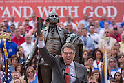 "Former Texas Gov. Rick Perry holds a bible as he address a gathering of evangelical Christians during the ""Stand With God"" rally  August 29, 2015 in Columbia, SC. Thousands of conservative Christians gathered at the State House to rally against gay marriage and listen to GOP presidential candidates Gov. Rick Perry and Sen. Ted Cruz speak."