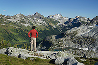 Adult male hiker in red shirt relaxing in Marriott Basin, Coast Mountains British Columbia