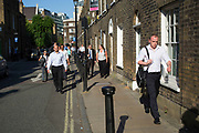 London, UK. Thursday 9th July 2015. Tube and train strikes caused misery for commuters with the entire London Underground network shut down and many rail services cancelled. The strike was in protest at longer working hours announced due to the tube system being open all night on weekends. Instead of taking public transport, many people decided that it was best to walk, which made normally quiet streets busy with workers walking home.