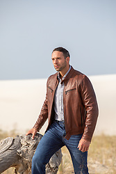 hot 30 year old man in a leather jacket outdoors good looking man in a leather jacket outdoors