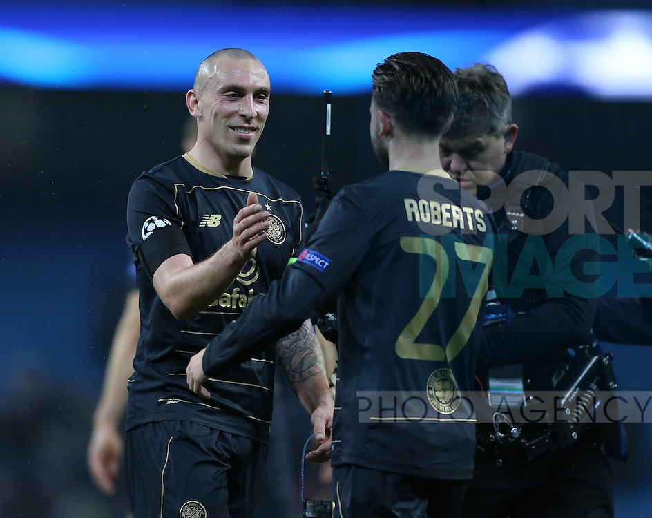 A smile from Scott Brown of Celtic as he offers his hand to Patrick Roberts of Celtic on a job well done during the Champions League Group C match at the Etihad Stadium, Manchester. Picture date: December 6th, 2016. Pic Simon Bellis/Sportimage