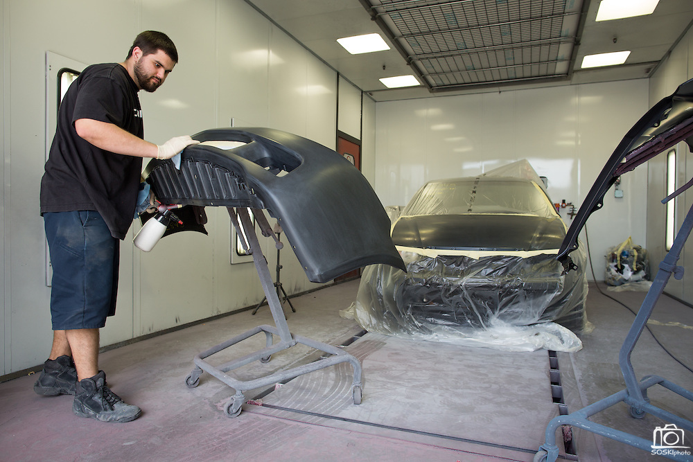 Paint Prepper Neil Perry cleans a bumper before painting at T.G.I.F. Body Shop, Inc., in Fremont, California, on April 17, 2014. (Stan Olszewski/SOSKIphoto)