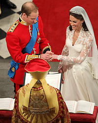 Prince William and Kate Middleton exchange rings during their wedding service at Westminster Abbey, London.