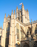 English flag flying on the tower of the Abbey church, Bath, Somerset, England