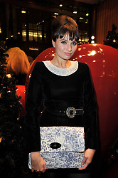 GIZZI ERSKINE at a party to celebrate the launch of the new Mulberry leather case for Apple's iPhone held at the Mulberry store, Bond Street, London on 5th November 2009.