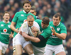 Mike Brown of England is tackled by Donnacha Ryan of Ireland - Mandatory by-line: Ken Sutton/JMP - 18/03/2017 - RUGBY - Aviva Stadium - Dublin,  - Ireland v England - RBS 6 Nations