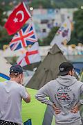 The Turkish flag flies above the Union Jack tomark a tent - or as a symbol of teh future post referendum? The 2016 Glastonbury Festival, Worthy Farm, Glastonbury.