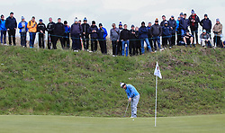 Lee Westwood putts on the 10th green during day two of the Betfred British Masters at Hillside Golf Club, Southport.