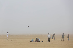 © Licensed to London News Pictures.  20/04/2021. Margate, UK. Members of the public enjoy warm and foggy weather in Margate, east Kent. As a mini heatwave is forecast to hit parts of UK this week with high temperatures reaching 22 celsius. Photo credit: Marcin Nowak/LNP