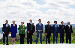 President of the European Council Donald Tusk, left to right, Prime Minister of the United Kingdom Theresa May, Chancellor of Germany Angela Merkel, President of the United States Donald Trump, Canada's Prime Minister Justin Trudeau, President of France Emmanuel Macron, Prime Minister of Japan Shinzo Abe, Prime Minister of Italy Giuseppe Conte, and President of the European Commission Jean-Claude Juncker pose for a family photograph during the G7 leader's summit in La Malbaie, Quebec, Canada on Friday, June 8, 2018. Photo by Sean Kilpatrick/CP/ABACAPRESS.COM