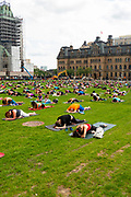A noon yoga gathering on the lawn of the Canadian Parliment; Ottawa, Ontario, Canada.