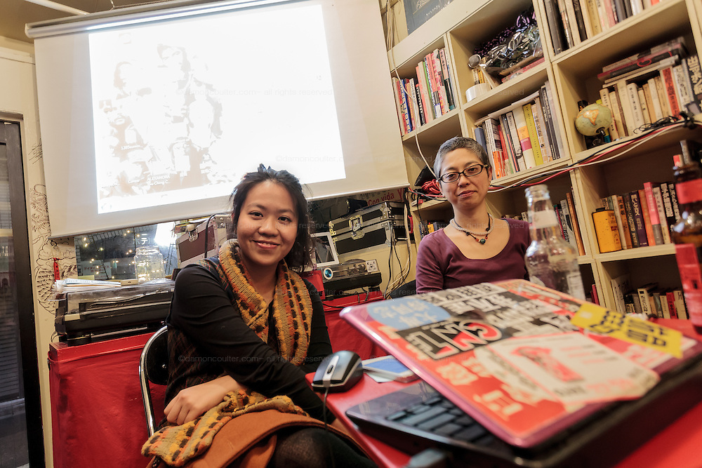 Activist, Alexandra Chan (left) from Hong Kong workers' rights NGO, SACOM gives a talk at Cafe Lavanderia with journalist, Chie Matsumoto (right) about workers rights in factories in China that supply Japanese brand Uniqlo. Shinjuku, Tokyo, Japan. Friday, January 16th 2015