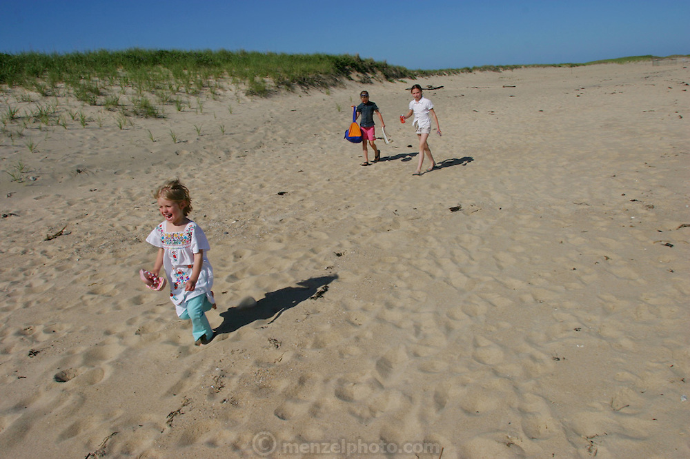 Playing on the beach at Martha's Vineyard, Massachusetts. MODEL RELEASED.