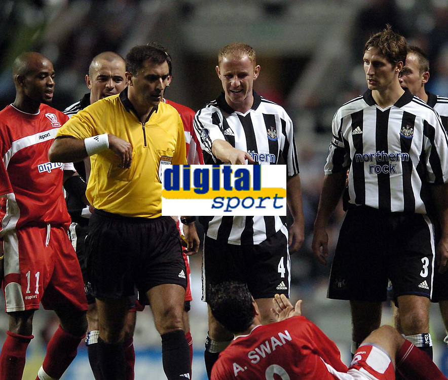 Photo. Jed Wee.<br /> Newcastle United v Hapoel Bnei Sakhnin, UEFA Cup, 16/09/2004.<br /> Newcastle's Nicky Butt tries to plead his case in the scuffle that led to both him and Hapoel's Abas Swan being dismissed<br /> NORWAY ONLY