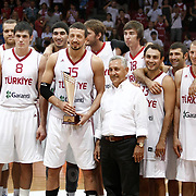 Turkish players Hidayet TURKOGLU (C) celebrate with the Istanbul Cup championship trophy during their Istanbul CUP 2011match played Montenegro between Turkey at Abdi Ipekci Arena in Istanbul, Turkey on 25 August 2011. Photo by TURKPIX