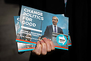 A Brexit Party supporter holds leaflets as they canvass for the upcoming European elections on the street in Dagenham Heathway, London, England on May 04, 2019.  Britain must hold European elections on May 23 or leave the European Union with no deal on June 01 after Brexit was delayed until  October 31 2019 after Prime Minister, Theresa May failed to get her Brexit deal approved by Parliament.