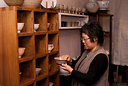 A ceramics store owner in her store in Insadong, the tourist and artisans quarter of Seoul.