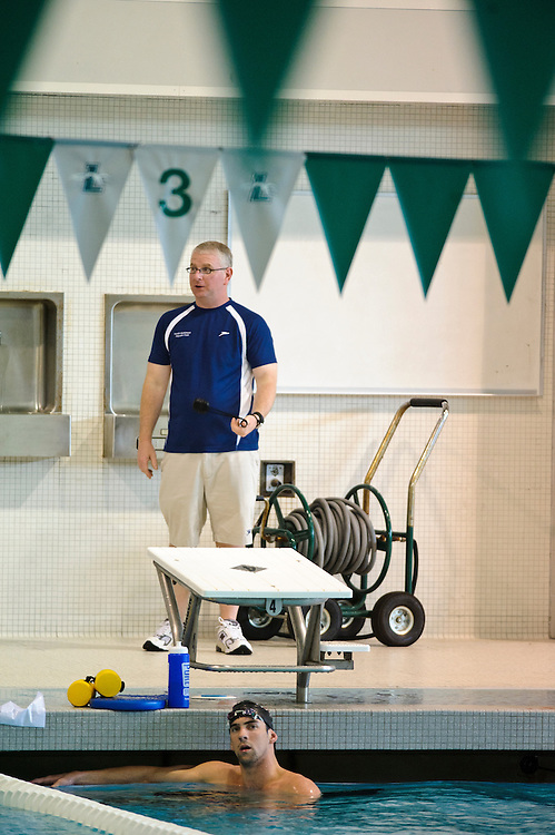 (photo by Matt Roth).Thursday, May 7, 2009..North Baltimore Aquatic Club coach Bob Bowman watches Michael Phelps during practice at the Loyola College Aquatic Center in Baltimore, Thursday, May 7, 2009.