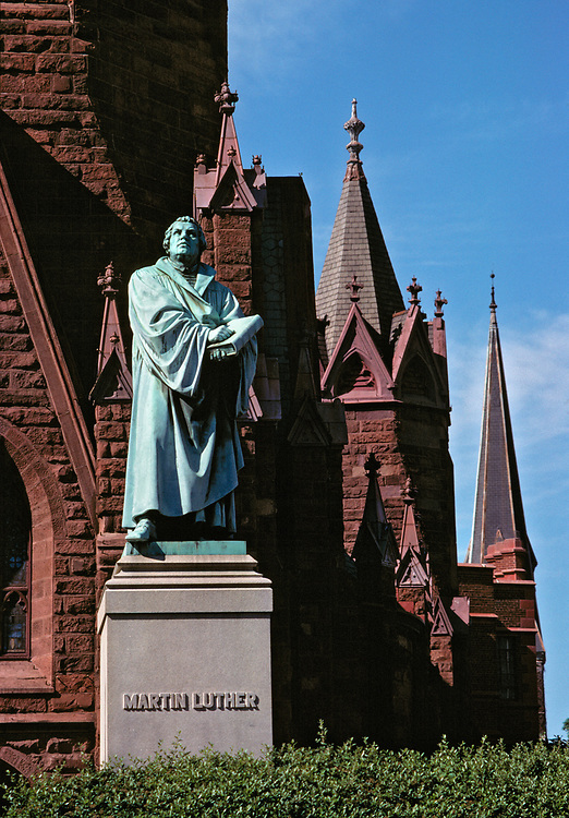 The imposing statue of Martin Luther gazes skyward at Luther Place Memorial Church, Washington, DC.