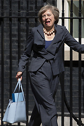 Home Secretary Theresa May jokes with the press after going to the wrong car as she leaves Prime Minister David Cameron's final cabinet meeting, taking over as Leader of the Conservative Party and Prime Minister on Wednesday 13th July 2016.