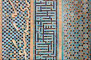 """Detail of glazed tile and terracotta script view of khanqah portal on the right flank of the 13th century Shaykh 'Abd al-Samad Shrine complex. The central part is made up of a square kufic pattern meaning """"There is no God but Allah, Mohammed is the prophet of God and Ali is the Imam from Allah."""" The left script reads """"in the year of sixteen."""" The sentence is incomplete. Natanz, Iran, 2008"""