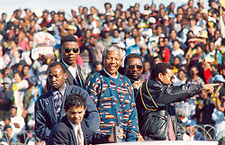 Nelson Mandela with this ANC supporters.