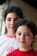 Jordan . Amman. Refugees from Syria. April 15th 2013. Two young girls.