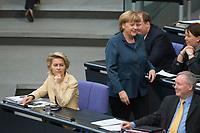 18 APR 2013, BERLIN/GERMANY:<br /> Angela Merkel (R), CDU Bundeskanzlerin, laeuft auf dem Weg zu ihrem Platz, an Ursula von der Leyen (L), CDU, Bundesarbeitsministerin, vorbei, Debatte zur Einfuerhung von verbindlichen Frauen-Quoten fuer Aufsichtsraete, die Foerderung der Chancengleichheit von Maennern und Frauen, Plenum, Deutscher Bundestag<br /> IMAGE: 20130418-01-095<br /> KEYWORDS: Sitzung