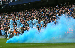 A flare is set off as Manchester City celebrate their side's second game of the game